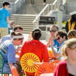 People sitting on Memorial Union Terrace chairs