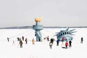 Image of Lady Liberty on frozen Lake Mendota surrounded by visitors