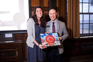 Argyle Wade presenting award to Sarah Piñón