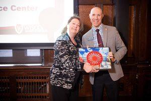 Argyle Wade presenting award to Kris Wurgler