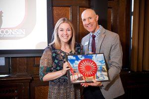 Argyle Wade presenting award to Kayla Hackl