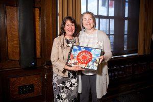 Mari Magler presenting award to Cathy Trueba