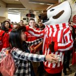 Photo of a student dancing with Bucky