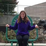 Mara Matovich sitting on large Terrace Chair outside of Union South