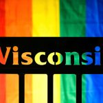 The word Wisconsin against the rainbow colors of a gay pride-themed flag