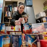 Photo of a woman sorting food at a food pantry