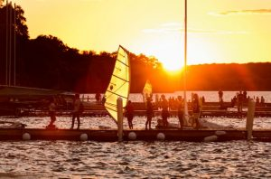 Photo of students and sail boards at the Union Terrace at sunset