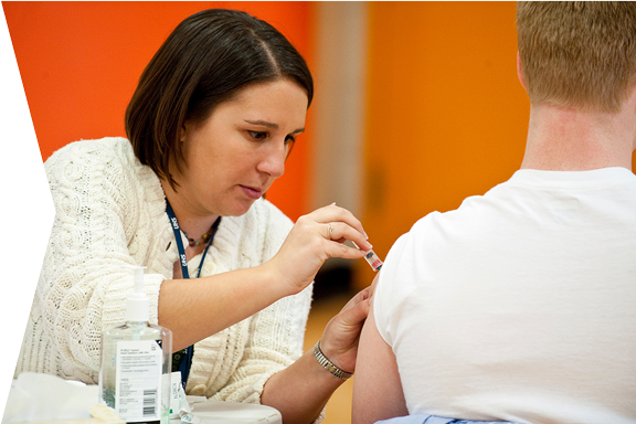 Student getting a flu vaccine shot at a University Health Services event.