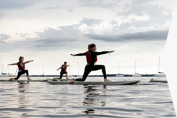 woman balances on stand up paddleboard