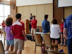 Student staff speak to guests