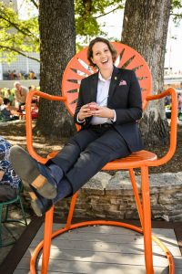 Dean of Student Christina Olstad sits in a large Union chair